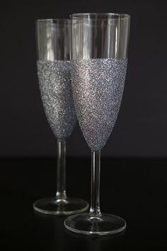 DIY glittered glassware ~ Dishwasher safe! Loose glitter + Martha Stewart Crafts Decoupage Glue #glitterchampagneglasses