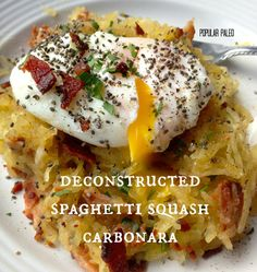 Deconstructed Spaghetti Squash Carbonara 3     Ingredients: 1 spaghetti squash, roasted (harvested strands equal about 3 cups) 1 cup chopped, cooked bacon or pancetta 4 garlic cloves, sliced 1 TBSP chopped flat-leaf parsley 1/4 cup sliced scallions or shallots 1 tsp white wine vinegar 1/4 cup bacon (or pancetta) fat Salt and pepper, to taste 4-6 poached eggs (one or two per person)