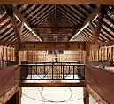 A restored barn that houses a basketball court.