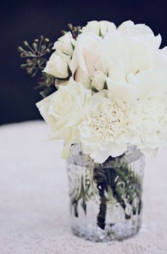I like this for a center piece just would add the colour theme of the wedding