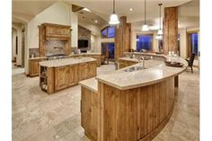 This kitchen is amazing! Love the floor, counter tops, and the large open space