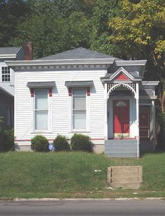 great example of a shotgun house in louisville, ky. lovely detailing.