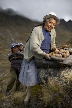 Portrait of a woman with a basket of potatoes