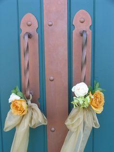 Fresh flowers on barn door handles