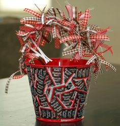 DIY- Crazy Candy Wrapper Buckets- I don't know if I would put quite that many ribbons on it but this would be cute with some Tootsie rolls and other candy in it for a cute little gift. They also make candy wrapper bracelets and belts (that I have on this board) that you could stick in there.