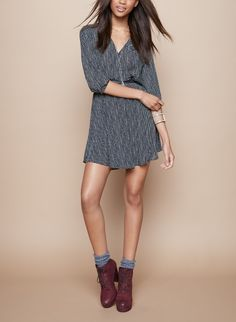Cute for fall. This faux wrap dress will look cute with booties or oxfords.