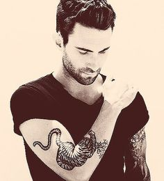 Adam Levine...is more lovely in a suit and tie