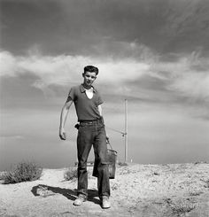 """Dazey Boy: October 1939. """"Dazey farm. Seventeen year old boy going to feed the pigs. Homedale district, Malheur County, Oregon."""" Medium-format nitrate negative by Dorothea Lange for the Farm Security Administration."""