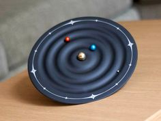 Become mesmerized as the planets on the Orbit Planet Clock circulate around the sun while they tell time.