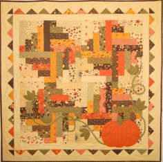 """Harmony"" fall quilt pattern with pumpkin at Ribbon Candy Quilt Company"