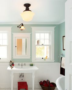 This bathroom is wonderful. I really want the schoolhouse light fixtures from rejuvenation. I love the idea of wainscoting, but I don't want bead-board. The medicine cabinet is perfect and the wall color is beautiful.