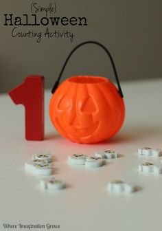 Halloween math games for preschooler! A simple and fun counting and letter recognition activity for kids with a fun Halloween theme!