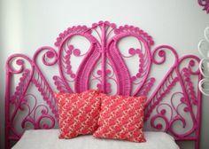Vintage wicker headboard spray painted pink - love!