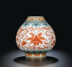 A RARE DOUCAI AND IRON-RED FLORAL VASE SEAL MARK AND PERIOD OF QIANLONG - Sotheby's