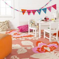 bright coral and pink rug for a nursery