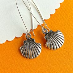 $7.00.  CLAM SHELL EARRINGS on French wires.  I'm dreaming of Summer!  Favorite Vendor.