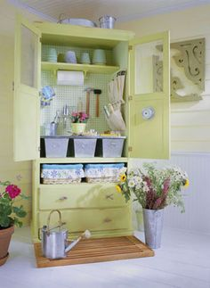 Big TV armoire...as a potting shed.