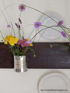Re-used tin cans make great vases