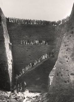 Excavating the Royal Cemetery at Ur. This photo gives some idea of the depth to which some of the tombs were buried. Ur was an ancient Sumerian city-state in Mesopotamia. Located in Tell el-Muqayyar, present-day Iraq.