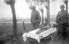 Giving a fallen comrade a proper burial, the smallest consolation for an otherwise purposeless death; Western Front, summer 1940.