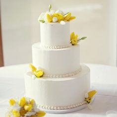 Simple three tiered white wedding cake with fresh yellow tulips and roses | Kelly Maughan Photography | Short North Piece of Cake
