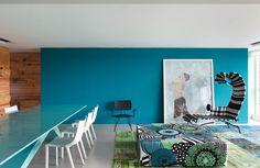 blue wall + flowered pouff
