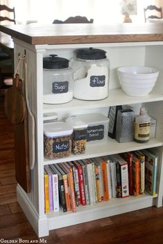 I LOVE this kitchen island - cook books, flour,  sugar, mixing bowels :)