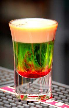Fallen Froggie ~ 0.5 oz Midori Melon Liqueur, 0.5 oz Baileys Irish Cream, splash of Grenadine. Mix equal parts of Melon Liqueur and Baileys Irish Cream. Splash a bit of Grenadine on top.