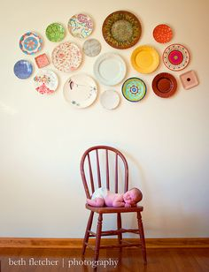 ok i like the plates on the wall idea and then i realized theres a baby on the chair haha but whatever