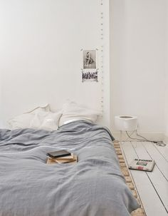 minimalist. bed on floor. light string.