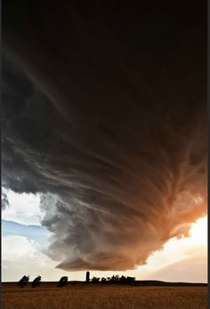 "Epic supercell thunderstorm clouds in Kansas from photographer Camille Seaman. - I see this and think, ""God help that farmer!!! Silo's right underneath that thing!!!"""