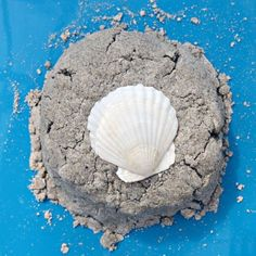 Recipe for sand foam dough for sensory play using real sand. It's smooth and crumbly, but can be form into shapes.
