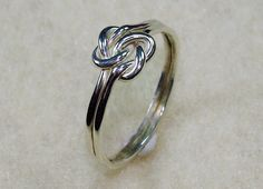 $20.00 Mini Celtic Double Love Knot Ring with Argentium Silver    I own this :)