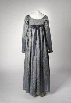Dress: ca. 1810-1815, English, hand-sewn, shot silk with floral pattern, silk corded trim at the band, cotton tape drawstring fastening. silk ribbon at back (replacement).