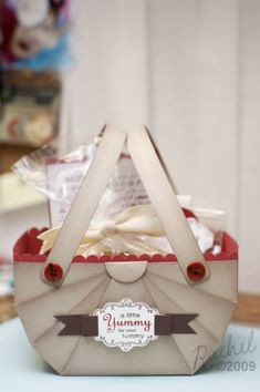 12 x 12 paper made into gift basket with scrapbooking supply. Tutorial.