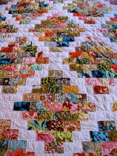 Ooh, I LOVE this scrappy rectangles pattern for this quilt. Charming.
