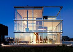 Dutch architect Hans van Heeswijk designed his own home, a waterfront abode called Rieteiland House on the recently developed island of IJburg near Amsterdam. I'm always insanely jealous of architects because they always live in the nicest homes. No fair.
