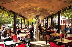 The long pavilion  full of sidewalk cafes on Granada's Paseo de los Tristes (The Melancholy Walk)