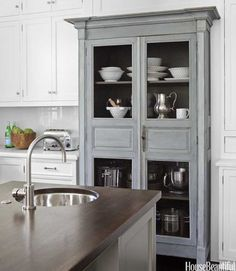 Love this cabinet! Create a butlers pantry right in the kitchen! Everything close by.
