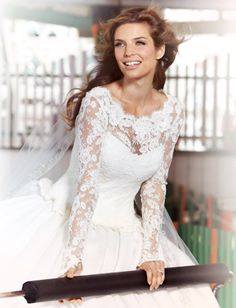 From our wedding dress feature, shot at Playland in Rye, featured in Westchester/Hudson Valley Weddings 2013 issue: Marchesa Kate Middleton-inspired, long-sleeved, lace-bodiced gown with bateau neckline and full gazar skirt. Photography by Gary Lupton.