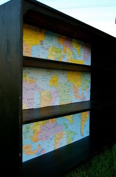 World Bookcase created from yard sale bookcase and dollar store maps!  perfect addition to a study, kids room or classroom for your global kids!