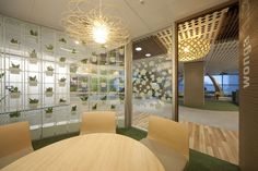Classy vertical garden...make a curved wall in your office to make a visual impression and partition off a work space. more at www.greendesign.com.au