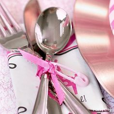 Tie up cutlery with a bright ribbon and string on an itsy-bitsy diaper pin. Too cute for a girl baby shower!