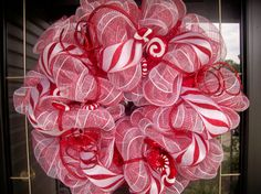 Gorgeous!  Instructions for a similar-looking wreath can be found at:  http://blog.mardigrasoutlet.com/2010/11/candy-cane-stripe-holiday-wreath-ez.html