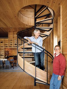 Bobbie Callahan and Ed Hayes by their spiral staircase in their summer home in North Haven, Maine. Published in Dwell Magazine, July/August 2009. Photo by: Raimund Koch   Read more: http://www.dwell.com/articles/A-Northern-Haven.html