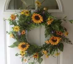 Sunshine On My Shoulders Artificial Sunflower Wreath For Front Door Wreaths For Door,http://www.amazon.com/dp/B00JLVVDYQ/ref=cm_sw_r_pi_dp_ANvztb1CMNAZW49D