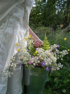 Country girl gathering flowers