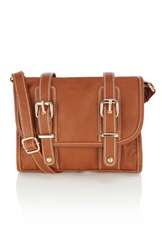 This mini satchel bag has lock fastenings to the body and an inner zip pcket with a mobile phone pocket too. WIth a long strap going across the body, this piece is great for carrying your everyday essentials.