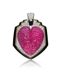 A Tourmaline, Diamond, and Enamel Pendant/Brooch, 1960's, by David Webb. Designed as a shield-shaped pendant, centering on a floral-carved heart-shaped pink tourmaline, to the circular-cut diamond plaque framed by a polished gold border and black enamel, mounted in 18K yellow gold and platinum.