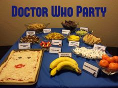 """Food spread from a Doctor Who party - Lady Cassandra pizza, """"Bow ties are cool"""" pasta salad, """"I want chips"""" (British chips, that is - fries), Tardis blue corn chips, Exploded Slitheen: Broccoli dip, """"Always take a banana to a party"""", """"Stupid old satsumas"""", The best dessert in the universe: Nanaimo bars, Adipose, Fish sticks and custard, """"Fezzes are cool"""": Rolos."""
